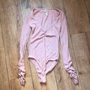 Free people pink bodysuit